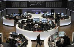 Traders are pictured at their desk under the DAX board at the Frankfurt stock exchange December 12, 2012. REUTERS/Remote/Pawel Kopczynski (GERMANY - Tags: BUSINESS)