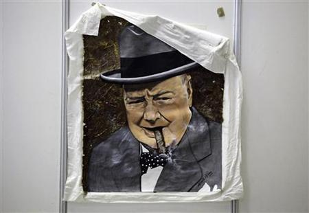 A painting of late British Prime Minister Winston Churchill by Cuban artist Ernesto Milanes is seen at the XIV Havana Cigar Festival in Havana March 2, 2012. REUTERS/Desmond Boylan
