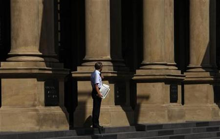 A trader is pictured outside the Frankfurt stock exchange, July 16, 2009. REUTERS/Johannes Eisele