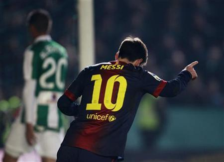 Barcelona's Lionel Messi celebrates after scoring against Cordoba during their Spanish King's Cup soccer match at Nuevo Arcangel stadium in Cordoba December 12, 2012. REUTERS/Marcelo del Pozo