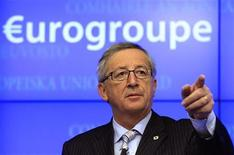 Luxembourg's Prime Minister and Eurogroup chairman Jean-Claude Juncker speaks during a news conference after a Eurogroup meeting in Brussels December 13, 2012. Euro zone finance ministers and officials approved releasing the next payment of aid to Greece at a meeting in Brussels on Thursday. REUTERS/Yves Herman (BELGIUM - Tags: POLITICS BUSINESS)