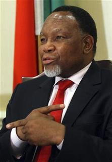 South Africa's Deputy President Kgalema Motlanthe gestures during a news conference at China World Hotel in Beijing, September 29, 2011. REUTERS/China Daily