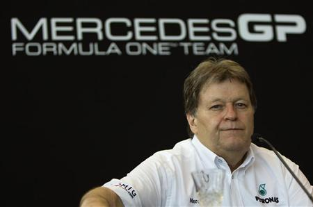 Norbert Haug, president in charge of Mercedes-Benz motorsport activity, attends a news conference at the Mercedes showroom in Manama March 11, 2010. REUTERS/Caren Firouz