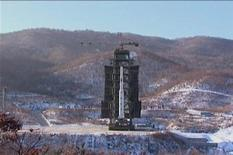 A video grab from KCNA shows the Unha-3 (Milky Way 3) rocket before it was launched at the North Korea's West Sea Satellite Launch Site, at the satellite control centre in Cholsan county, North Pyongan province released by KCNA in Pyongyang December 13, 2012. KCNA said the video was taken December 12, 2012. REUTERS/KCNA