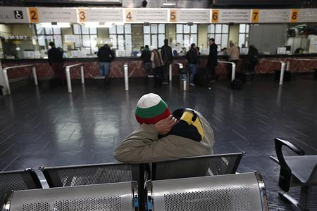 A man sits in front of ticket desks at Thessaloniki railway station, northern Greece November 29, 2012. REUTERS/Yorgos Karahalis