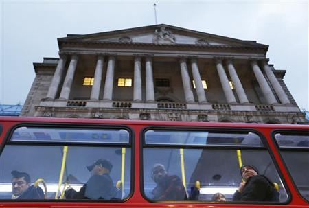 A bus passes the Bank of England in the city of London November 26, 2012. REUTERS/Olivia Harris