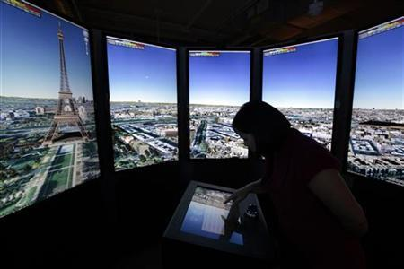 Katharine Ng zooms in to Paris on panoramic Google Maps screens at the Google campus near Venice Beach, in Los Angeles, California January 13, 2012. REUTERS/Lucy Nicholson
