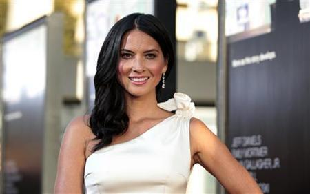 Cast member Olivia Munn poses at the premiere of the HBO television series ''The Newsroom'' at the Cinerama Dome in Los Angeles, California June 20, 2012. REUTERS/Mario Anzuoni/Files
