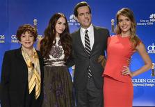 Hollywood Foreign Press Association President Aida Takla-O'Reilly (L-R), Actress Megan Fox, Actor Ed Helms and Actress Jessica Alba pose for photographers at the announcement of nominations for the 70th annual Golden Globe Awards in Beverly Hills, California December 13, 2012. The awards will be presented on January 13, 2013. REUTERS/Phil McCarten