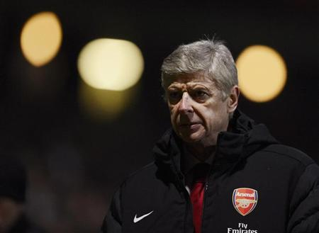 Arsenal's coach Arsene Wenger reacts during their English League Cup soccer match against Bradford City in Bradford, northern England December 11, 2012. REUTERS/Nigel Roddis