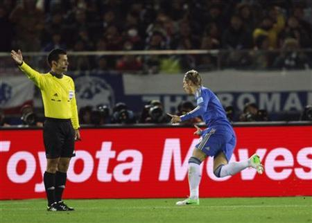 Fernando Torres of Britain's Chelsea reacts after scoring a goal against Mexico's Monterrey during their Club World Cup semi-final soccer match in Yokohama, south of Tokyo December 13, 2012. REUTERS/Yuya Shino