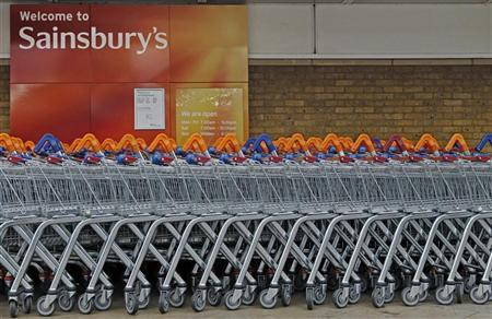 Shopping trolleys are lined up in front of a Sainsury's supermarket in London October 5, 2011. REUTERS/Luke MacGregor