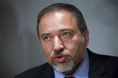 Israel's Lieberman, facing indictment, says need not...