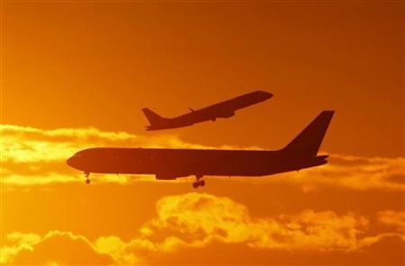 Passenger planes land and take off at Sydney airport April 28, 2009. REUTERS/Tim Wimborne/Files