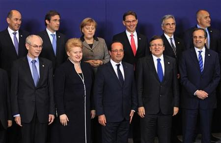 European Union leaders pose for a family photo during a EU summit in Brussels December 13, 2012. European governments reached a landmark deal on Thursday that gives the European Central Bank new powers to supervise banks, boosting confidence in the single currency bloc as it enters the fourth year of its debt crisis. REUTERS/Yves Herman (BELGIUM - Tags: POLITICS BUSINESS)