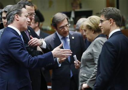 Britain's Prime Minister David Cameron talks to his Finnish counterpart Jyrki Katainen (R) while Portugal's Prime Minister Pedro Passos Coelho (C) listens to Germany's Chancellor Angela Merkel (2nd R) during a European Union leaders summit in Brussels December 13, 2012. REUTERS/Francois Lenoir