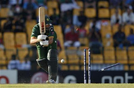 Pakistan's Shahid Afridi is bowled out by Australia's Mitchell Starc (unseen) during their Twenty20 World Cup Super 8 cricket match in Colombo October 2, 2012. REUTERS/Dinuka Liyanawatte