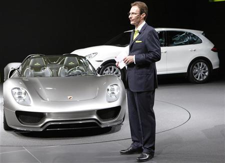 File photo of CEO Michael Macht of German car manufacturer Porsche standing beside a Porsche 918 Spyder car and a Porsche Cayman (back) car during the first media day of the 80th Geneva Car Show at the Palexpo in Geneva March 2, 2010. REUTERS/Denis Balibouse/Files