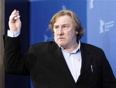 Actor Gerard Depardieu poses during a photocall to promote the movie ''Mammuth'' at the Berlinale International Film Festival in Berlin, February 19, 2010. REUTERS/Tobias Schwarz/Files