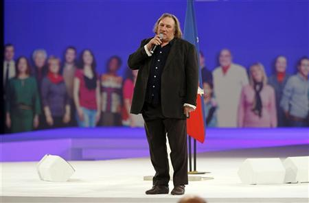 French actor Gerard Depardieu delivers a speech during a campaign rally for France's President Nicolas Sarkozy, candidate for the 2012 French presidential election, in Villepinte, northern Paris March 11, 2012. REUTERS/Charles Platiau