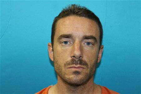 Brent Troy Bartel, 39, of the Fort Worth suburb of Richland Hills, Texas is shown in this police booking photograph on December 12, 2012. Bartel told authorities he carved a pentagram into the back of his 6-year-old son ''because it is a holy day'' in reference to the numerical date of 12-12-12, police said. REUTERS/ Richland Hills Police Department/Handout