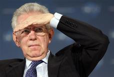 Italy's Prime Minister Mario Monti gestures at the World Policy Conference in Cannes in this December 8, 2012 file photo. REUTERS/Eric Gaillard/Files