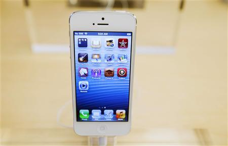 An Apple iPhone 5 phone is displayed in the Apple Store on 5th Avenue in New York in this September 21, 2012 file photo. REUTERS/Lucas Jackson/Files
