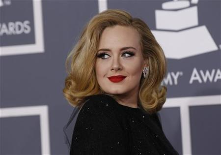 Singer Adele poses as she arrives at the 54th annual Grammy Awards in Los Angeles, California, February 12, 2012. REUTERS/Danny Moloshok/Files