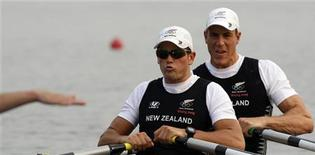 Rob Waddell and Nathan Cohen (L) of New Zealand prepare to start in the men's double scull heat 1 rowing competition during the Beijing 2008 Olympic Games at Shunyi Olympic Rowing Park August 9, 2008. REUTERS/Darren Whiteside