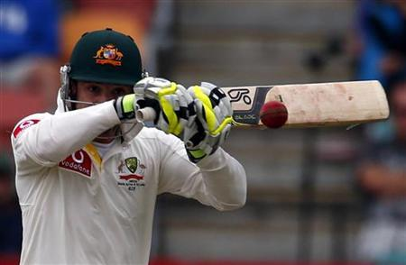 Australia's Phil Hughes plays a hook shot during the first day of play in the first test cricket match against Sri Lanka at Bellerive Oval in Hobart December 14, 2012. REUTERS/David Gray