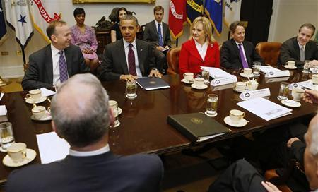 President Barack Obama (2nd L, facing camera) meets with members of the National Governors Association (NGA) Executive Committee in the Roosevelt Room of the White House in Washington, December 4, 2012. REUTERS/Larry Downing