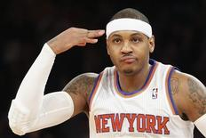 New York Knicks forward Carmelo Anthony gestures after hitting a three-pointer against the Los Angeles Lakers in the first quarter of their NBA basketball game in New York December 13, 2012. REUTERS/Adrees Latif