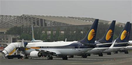 Jet Airways aircraft stand on the tarmac at the domestic airport terminal in Mumbai September 9, 2009. REUTERS/Punit Paranjpe/Files