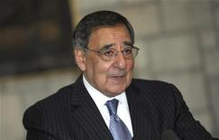 U.S. Defense Secretary Leon Panetta speaks about a suicide bombing near a NATO base, during a joint news conference with Afghan President Hamid Karzai at the Presidential Palace in Kabul December 13, 2012. REUTERS/Susan Walsh/Pool