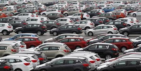 A worker walks through a parking lot of Kia cars ready for shipping, in its factory in Zilina, 200 kilometres north of Bratislava October 3, 2012. Carmakers that cut costs last decade in Western Europe like Volkswagen, or those who were never saddled with expensive factories there, such as Korea's Hyundai and Kia, are now investing in new designs, conquering new markets and ramping up production. Between them, VW Group, Mercedes, Kia and Hyundai have raised their share of the European market to 35.5 percent in the eight months to end August 2012, from 30 percent in the same period of 2010. Up the road in the foothills of Slovakia's Fatra mountains, the most modern factory owned by Korean carmaker Kia Motors looks set to beat its production goal of 285,000 SUVs, compact and family cars. Picture taken October 3, 2012. To match Insight AUTOS-CENTRALEUROPE/ REUTERS/Petr Josek (SLOVAKIA - Tags: TRANSPORT BUSINESS EMPLOYMENT)