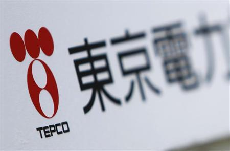 A Tokyo Electric Power Co (TEPCO) logo is pictured on a sign showing the way to the venue of the company's annual shareholders' meeting in Tokyo June 28, 2011. REUTERS/Yuriko Nakao