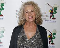 "Singer and songwriter Carole King poses on the arrivals line at ""A Celebration of Carole King And Her Music"" concert to benefit Paul Newman's The Painted Turtle Camp in Hollywood December 4, 2012. REUTERS/Fred Prouser"