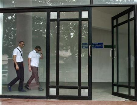 Italian sailors Salvatore Girone and Massimiliano Latorre (L) walk inside the police commissioner office building in Kochi September 4, 2012. REUTERS/Sivaram V/Files