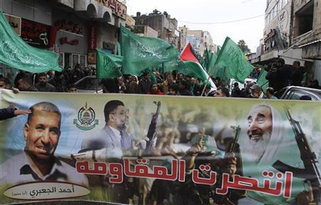 Palestinians wave Hamas flags during a rally celebrating what they claim to be Hamas' victory over Israel in the Gaza conflict, in the West Bank city of Ramallah November 23, 2012. Israeli troops at the Gaza border shot dead a Palestinian man and wounded 15 more on Friday, health officials said, in the first fatality since a ceasefire between the territory's Islamist rulers Hamas and Israel. The banner reads: ''The resistance has achieved victory.'' REUTERS/Mohamad Torokman