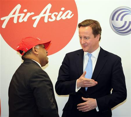 Britain's Prime Minister David Cameron speaks to AirAsia chief executive officer Tony Fernandes during a visit to Airbus UK in Broughton, north Wales December 13, 2012. REUTERS/Martin Rickett/Pool