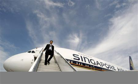 A Singapore Airlines staff member walks down a set of stairs from an Airbus A380 at Sydney International Airport in this October 26, 2007 file photo. REUTERS/Tim Wimborne/Files