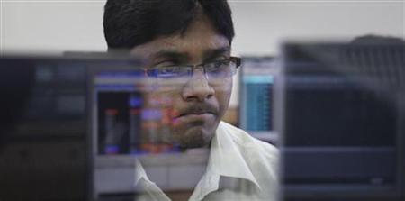 A broker monitors share prices at a brokerage firm in Mumbai August 5, 2011. REUTERS/Danish Siddiqui/Files