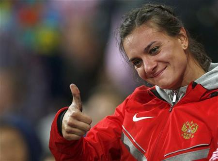 Russia's Yelena Isinbayeva gives a thumbs-up after winning bronze in the women's pole vault final during the London 2012 Olympic Games at the Olympic Stadium August 6, 2012. REUTERS/Mark Blinch