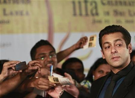 Bollywood actor Salman Khan (R) reacts on the green carpet for the International Indian Film Academy (IIFA) awards in Colombo June 5, 2010. REUTERS/Dinuka Liyanawatte/Files