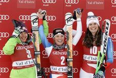 L-R Second placed Leanne Smith of the U.S., winner Lara Gut of Switzerland and her third placed team mate Nadja Kamer react on the podium after the Women's World Cup Downhill skiing race in Val d'Isere, French Alps, December 14, 2012. REUTERS/Robert Pratta