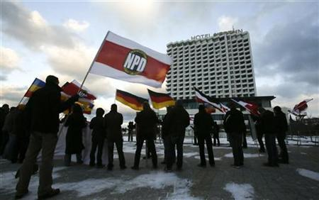 Members of the far-right National Democratic Party (NPD) attend a protest rally in front of a hotel where German state ministers are holding a conference in Rostock December 5, 2012. REUTERS/Tobias Schwarz (GERMANY - Tags: POLITICS CIVIL UNREST)