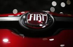 A company logo is seen on a Fiat car displayed on media day at the Paris Mondial de l'Automobile, September 28, 2012. REUTERS/Christian Hartmann