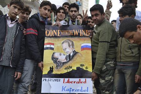 Demonstrators hold a placard during a protest against Syria's President Bashar al-Assad, after Friday prayers in Kafranbel near Idlib December 14, 2012. REUTERS-Raed Al-Fares-Shaam News Network-Handout