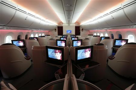 Seats and screens in the business class cabin of Qatar Airways' new Boeing 787 Dreamliner are seen after it arrived on it's inaugural flight to Heathrow Airport, west London December 13, 2012. REUTERS/Andrew Winning