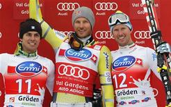 World Cup overall points leader Aksel Lund Svindal (C) of Norway celebrates on podium with second placed Matteo Marsaglia (L) of Italy and third placed Werner Heel of Italy after the men's World Cup Super-G race in Val Gardena, northern Italy, December 14, 2012. REUTERS/Alessandro Garofalo